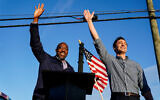 Then-Georgia Democratic candidates for US Senate Raphael Warnock, left, and Jon Ossoff, right, gesture toward a crowd during a campaign rally in Marietta, Georgia, November 15, 2020. (AP Photo/Brynn Anderson, File)
