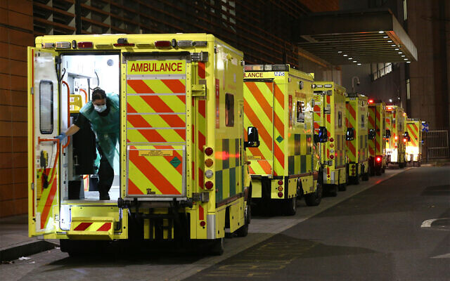 A row of ambulances are parked outside the Royal London Hospital in London,, December 29, 2020. (Yui Mok/PA via AP)
