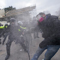 Pro-Trump rioters try to break through a police barrier at the US Capitol in Washington, January 6, 2021. (AP Photo/Julio Cortez)