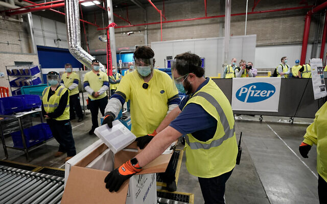 Boxes containing the Pfizer-BioNTech COVID-19 vaccine are prepared to be shipped at the Pfizer Global Supply Kalamazoo manufacturing plant in Portage, Michigan, Dec. 13, 2020. (AP Photo/Morry Gash, Pool, File)