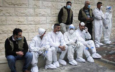 Palestinians sit as PA Prime Minister Mohammed Shtayyeh opens a hospital for COVID-19 patients in the West Bank city of Nablus, on January 16, 2021. (Nasser Ishtayeh/ Flash90)
