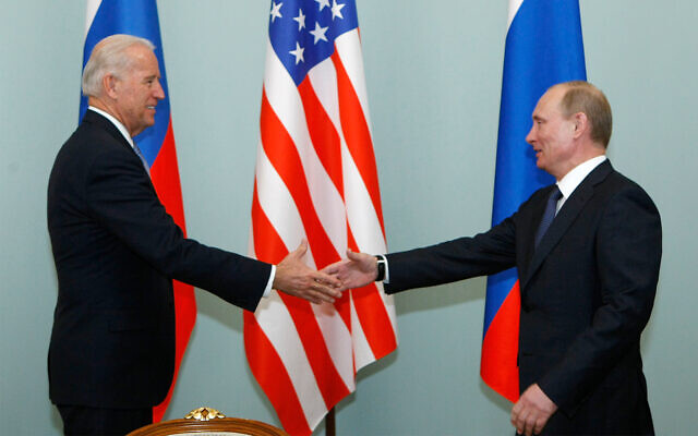 Then vice president of the United States Joe Biden, left, shakes hands with Russian Prime Minister Vladimir Putin in Moscow, Russia, March 10, 2011. (AP Photo/Alexander Zemlianichenko, File)
