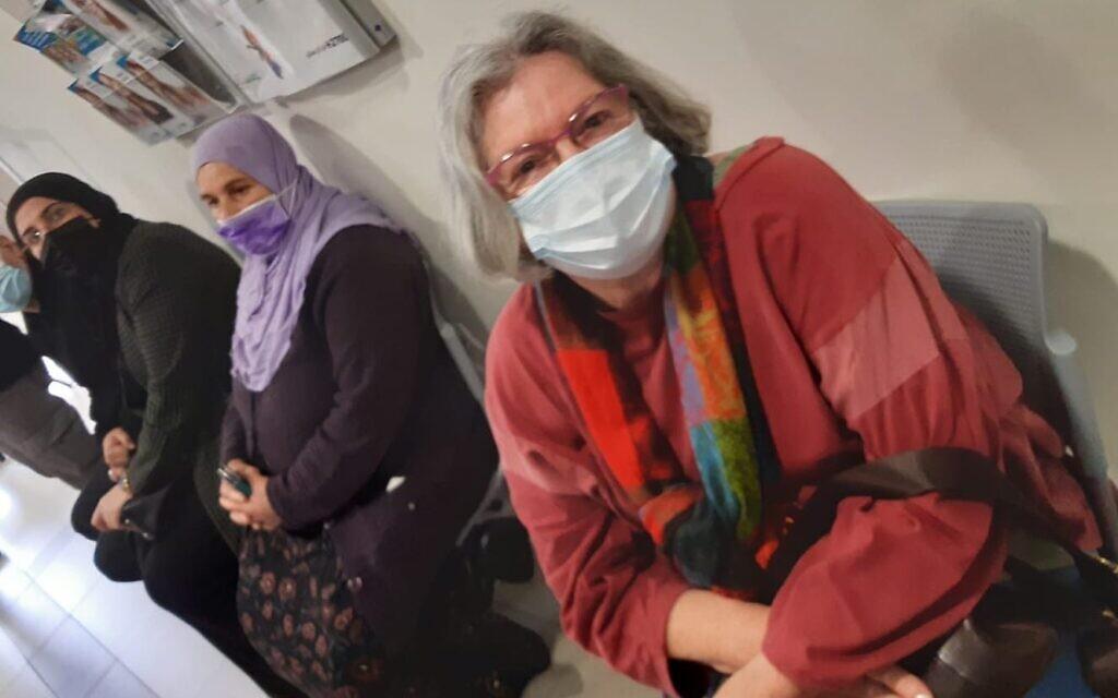 Naama Gatt, a 75-year-old kibbutznik, waiting for her vaccine in the Arab Israeli town of Baqa al-Gharbiyye, on January 3, 2020 (Nathan Jeffay/Times of Israel)