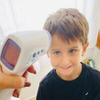 A kindergarten pupil in Ashdod has his temperature taken by the Thermoguard device (courtesy of Thermoguard)