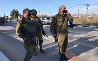 Israeli troops at the scene of a suspected attempted stabbing attack at the Gush Etzion Junction in the West Bank, January 5, 2021. (Israel Defense Forces_