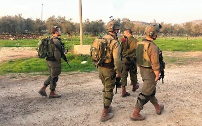 A photo released by the Israel Defense Forces shows soldiers in the West Bank following an attempted ramming and stabbing attack near the Palestinian town of Yabad on January 9, 2021. (Israel Defense Forces)