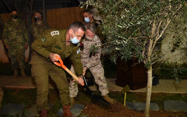 IDF Chief of Staff Aviv Kohavi, left, and the head of the US Central Command Gen. Kenneth McKenzie plant a tree in honor of the Jewish holiday of Tu Bishvat, on January 28, 2021. (Israel Defense Forces)