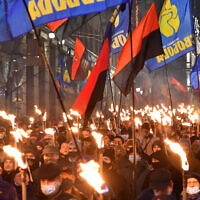 Participants of an annual event in honor of Stepan Bandera march through Kyiv, Ukraine on Jan. 1, 2021. (Genya Savilou/AFP)