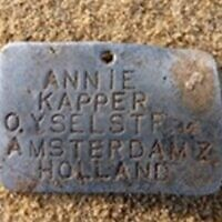 A name tag of a child found during excavations at Sobibor death camp in Poland. (Courtesy)