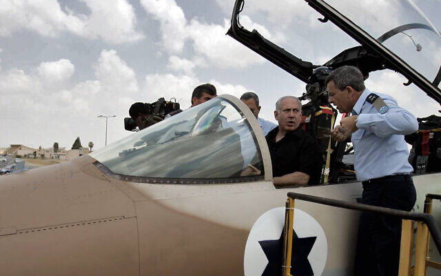 Prime Minister Benjamin Netanyahu and sits in the cockpit of F-15i fighter jet, August 11, 2009, during a visit to the Hatzerim air base in southern Israel. (Edi Israel/Flash90)      *** Local Caption *** ?????? ?????? ???? ????? ????? ???? ?????? ?????? ??? ?????? ??? ????? ?????