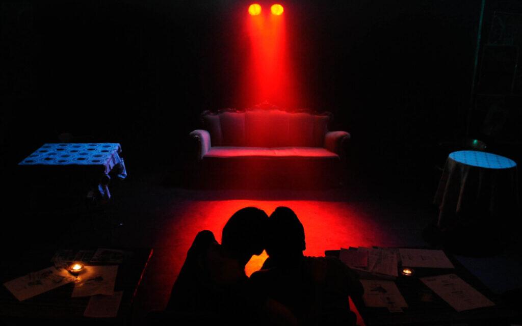 Illustrative: An Israeli couple wait for a play to begin in Tel Aviv on June 5, 2013. (Zuzana Janku/Flash 90)