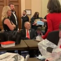 Several Republican lawmakers including Andy Biggs (seated), Marjorie Taylor Greene (L) and Markwayne Mullin (C) refuse offered masks while sheltering from the mob who stormed the US Capitol (Screenshot/YouTube)