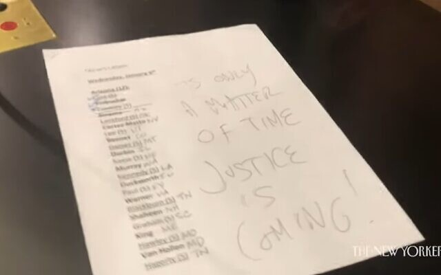 """A note written by Jacob Chansley aka Jake Angeli and left on US Vice President Mike Pence's desk reads: """"It's only a matter of time, Justice is coming!"""" (Screenshot/YouTube)"""
