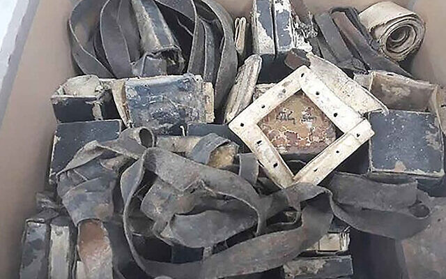 10 sets of tefillin that the Shem Olam Holocaust museum said were found in Warsaw, Poland. (Courtesy of Shem Olam Faith & the Holocaust Institute for Education, Documentation & Research via JTA)