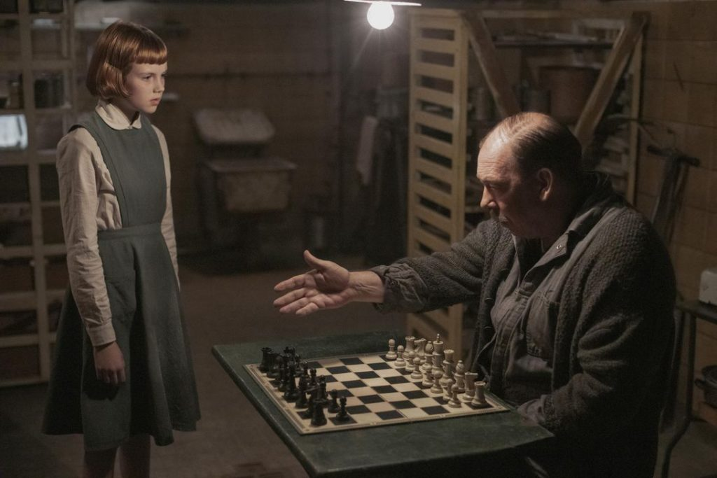 The character Beth Harmon with her mentor, Mr. Shaibel, at the orphanage in 'The Queen's Gambit' (Courtesy).