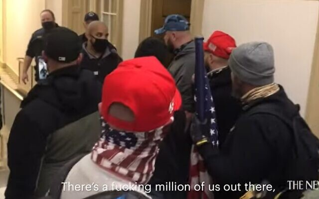 Pro-Trump rioters threaten police after breaking into the US Capitol on January 6, 2021 (Screencapture/YouTube)