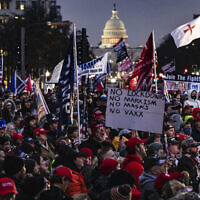 Supporters of US President Donald Trump gather for a rally at Freedom Plaza in Washington, DC, on January 5, 2021. A string of extremists are expected at the rally. (Samuel Corum/Getty Images via JTA)