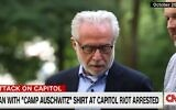 Wolf Blitzer says Kaddish at Auschwitz during a 2014 visit for a documentary. (Screenshot)