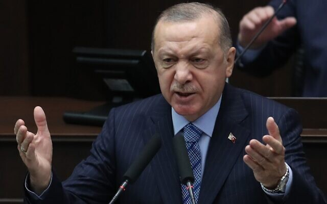 Turkish President and leader of the Justice and Development (AK) Party Recep Tayyip Erdogan speaks during a parliamentary group meeting on January 27, 2021, at the Grand National Assembly of Turkey (GNAT) in Ankara. (Adem ALTAN / AFP)