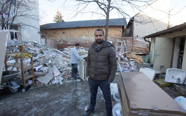 Sukhdeep Singh stands in front of the Laura Gatner House in Hirtenberg near Baden, Lower Austria, where he used to live, on January 22, 2021. (ALEX HALADA / AFP)