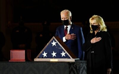 US President Joe Biden and First Lady Jill Biden pay their respects to late US Capitol Police officer Brian Sicknick, as he lies in honor in the Capitol Rotunda in Washington, DC February 2, 2021. (Erin Cchaff / POOL / AFP)