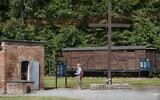 In this file photo taken on July 21, 2020 a woman is seen next to a gas chamber at the museum of the former Nazi Death Camp Stutthof, in Sztutowo, July 21, 2020. (Wojtek RADWANSKI / AFP)