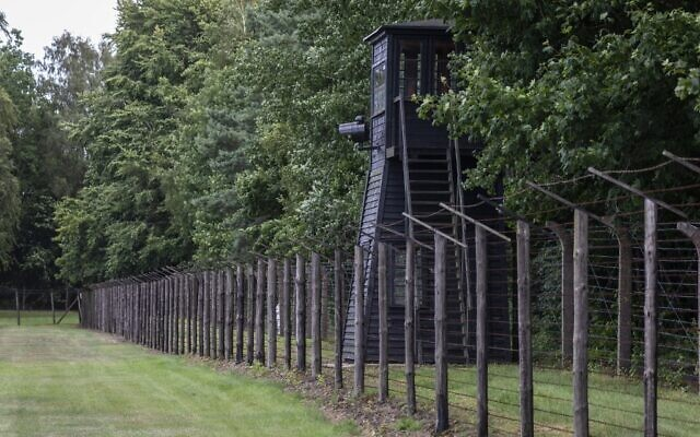 Barbed wire fence and a watch tower are seen at the former Nazi Death Camp Stutthof, in Sztutowo, July 21, 2020. (Wojtek RADWANSKI / AFP)
