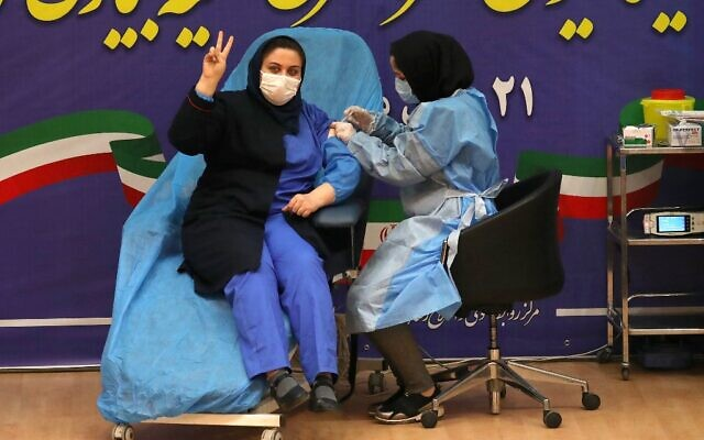 Iranian health worker Sara Gudarzi receives the COVID-19 vaccine as the country launches its inoculation campain, at the Imam Khomeini hospital in the capital Tehran, on February, 9, 2021 (ATTA KENARE / AFP)