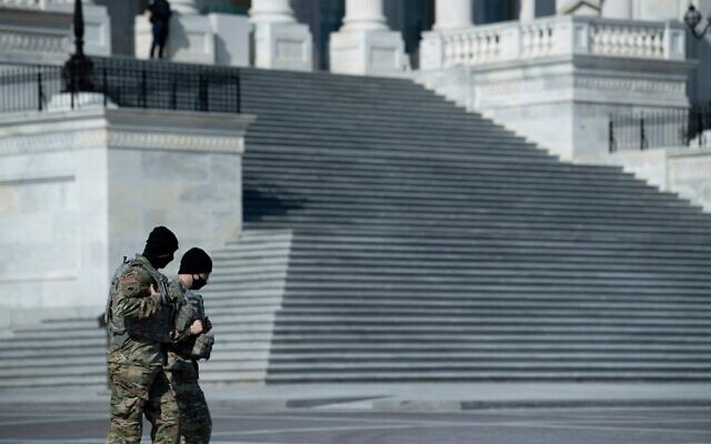 Members of the National Guard walk on Capitol Hill before the beginning of the first day of former US President Donald Trump's trial before the Senate February 9, 2021, in Washington, DC. (Brendan Smialowski / AFP)