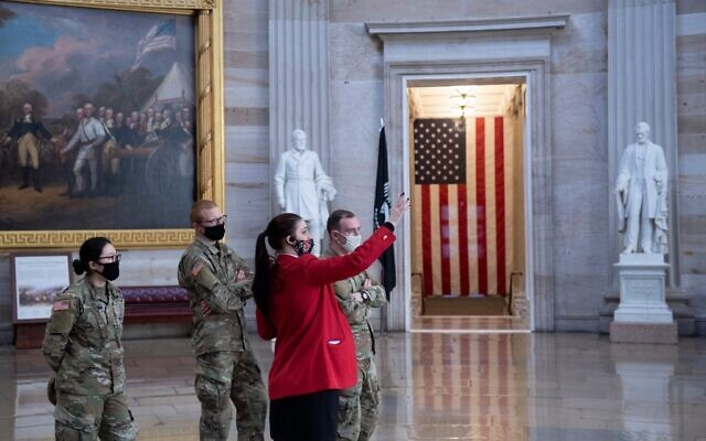 Members of the National Guard get a tour of the Rotunda on Capitol Hill before the beginning of the first day of former US President Donald Trump's trial before the Senate February 9, 2021, in Washington, DC. (Brendan Smialowski / AFP)