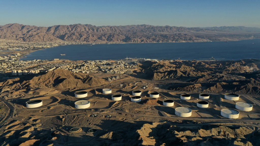This aerial photograph, taken on February 10, 2021, shows the oil storage containers of the Eilat Ashkelon Pipeline Company (EAPC) in the mountains near Israel's Red Sea port city of Eilat.  (MENAHEM KAHANA / AFP)