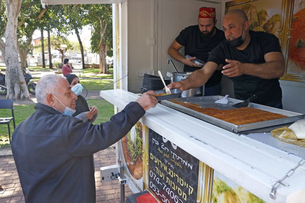 To encourage vaccination, Israeli cities serve free food with a side of  comfort | The Times of Israel