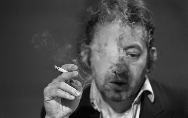 A file photo taken on March 11, 1984 shows French singer-songwriter Serge Gainsbourg smoking during the 7 sur 7 tv show at the Studio Cognacq-Jay in Paris. (PHILIPPE WOJAZER / AFP)