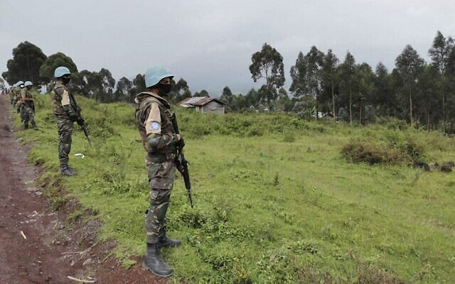 Moroccan soldiers of the MONUSCO (United Nations Organization Stabilization Mission in the DR Congo) patrol the road in the Kibumba area in the Virunga National Park, on February 22, 2021, where Italy's ambassador to the Democratic Republic of Congo was killed earlier when a UN convoy came under attack. (Alexis Hughet/AFP)