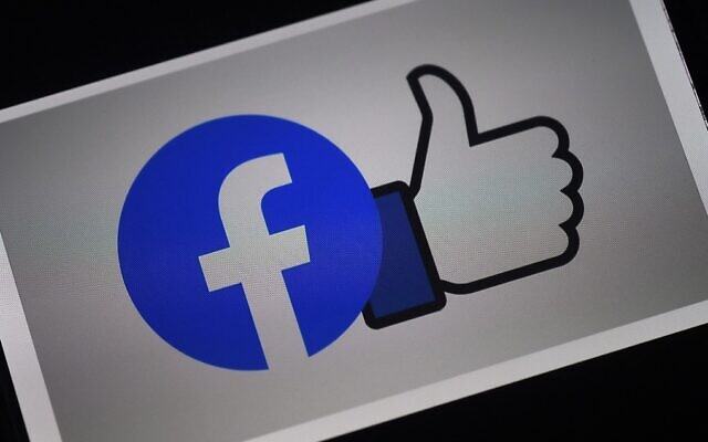 A Facebook App logo is displayed on a smartphone in Arlington, Virginia, March 24, 2020. (Olivier Douliery/AFP)