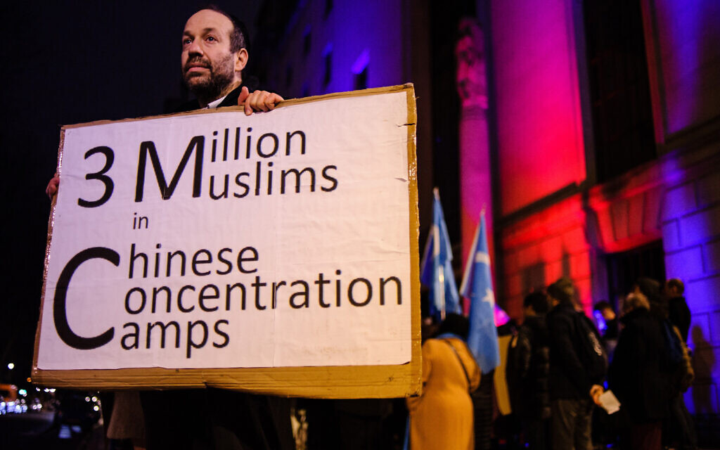 A Jewish man who identified himself as Andrew protests the oppression of China's Uighurs outside the Chinese Embassy in London, January 5, 2020. (David Cliff/NurPhoto via Getty Images/ via JTA/ SUE)