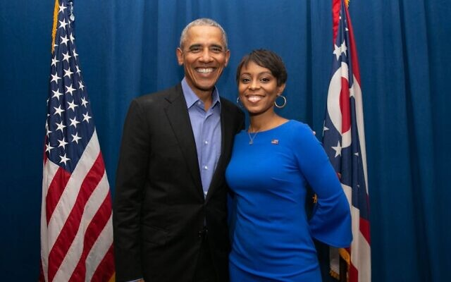 Shontel Brown poses with former US President Barack Obama in an undated image from her congressional campaign website. (Courtesy)