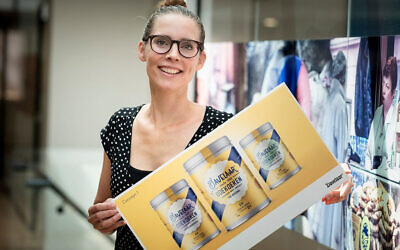 Renee Pater presents the design for the new label that her company, Patisserie Pater, produces in Zwaagdijk, the Netherlands. (Patisserie Pater/ via JTA)