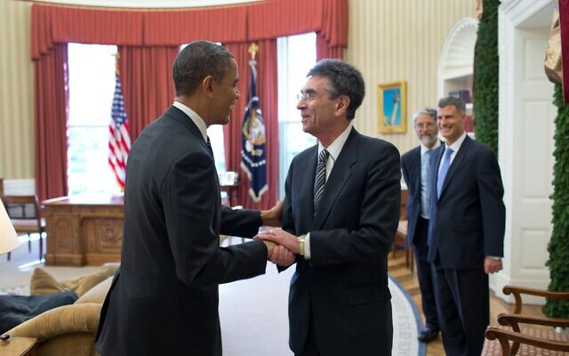 Dr. Robert Lefkowitz shakes hands with former president Barack Obama in 2012 prior to departing to Sweden to accept the Nobel Prize. (Courtesy)