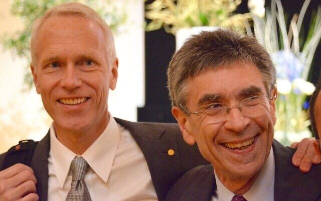 Dr. Brian Kobilka, left, with Dr. Robert Lefkowitz at the post-Nobel Prize lecture they gave. (Courtesy)