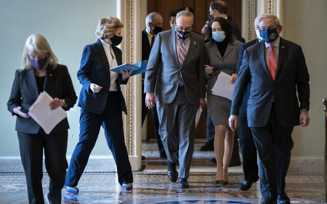 (L-R) Senator Patty Murray, Senator Debbie Stabenow, Senate Majority Leader Chuck Schumer, Senator Maria Cantwell and Senator Robert Menendez walk to a news conference on the first day of former President Donald Trump's second impeachment trial at the US Capitol on February 9, 2021 in Washington, DC. (Drew Angerer/Getty Images/AFP)