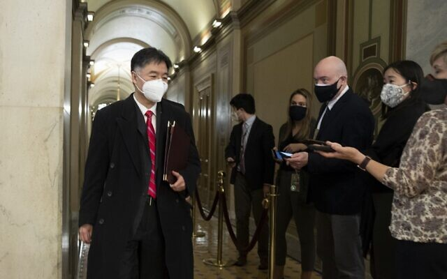 US House impeachment manager Rep. Ted Lieu (D-CA) (L) walks past members of the news media as he leaves at the end of the third day of former U.S. President Donald Trump's second impeachment trial at the U.S. Capitol on February 11, 2021 in Washington, DC. (Michael Reynolds-Pool/Getty Images/AFP