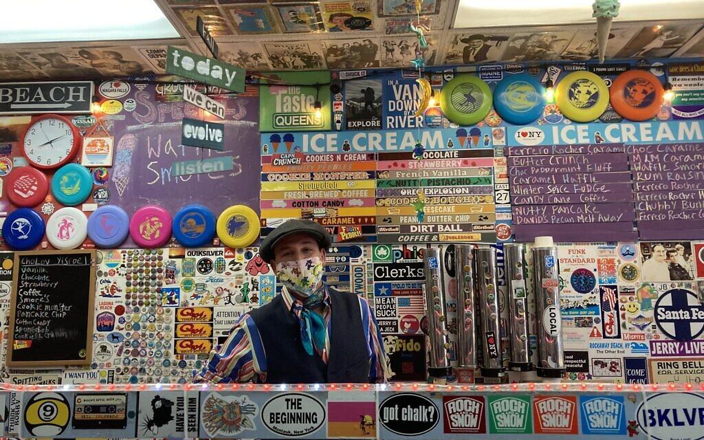 Bruce Becker behind the counter at Max and Mina's. (Shira Feder/ JTA)