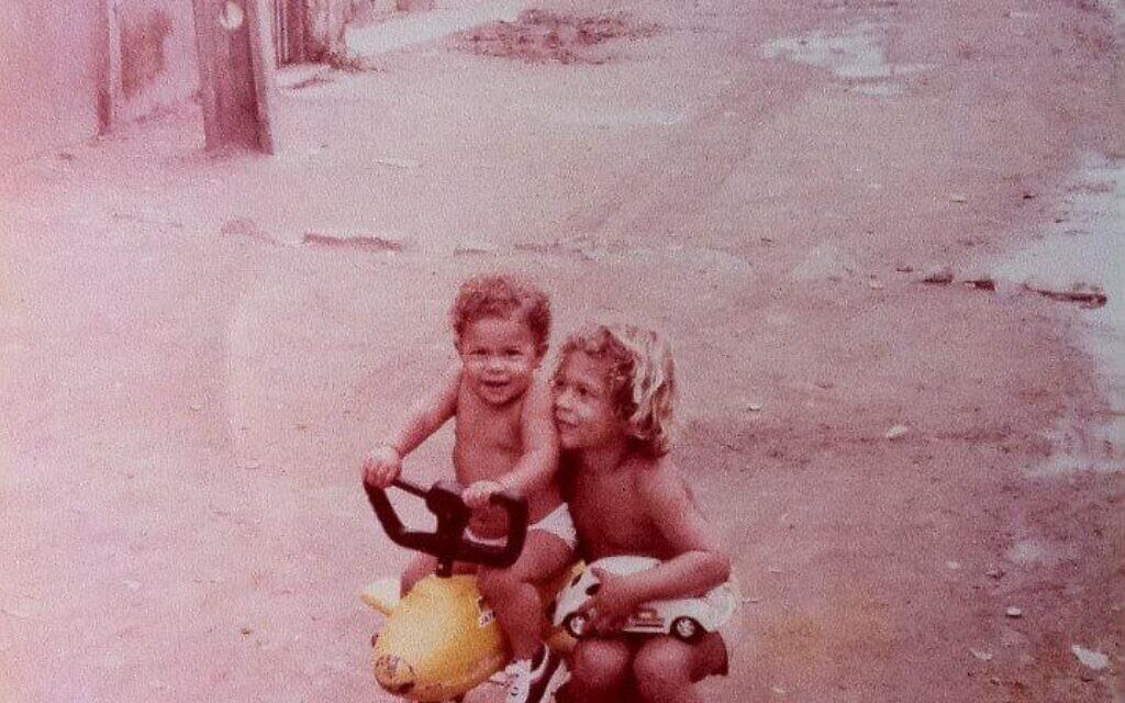 Alander Especie, right, with his sister Rednala in the Vila Vintem favela in Rio de Janeiro. (Courtesy of Especie/ via JTA)