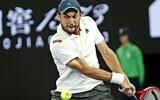 Aslan Karatsev returns a shot against Novak Djokovic at the Australian Open in Melbourne, Australia, Feb. 18, 2021 (Peter Haskin / Australian Jewish News)