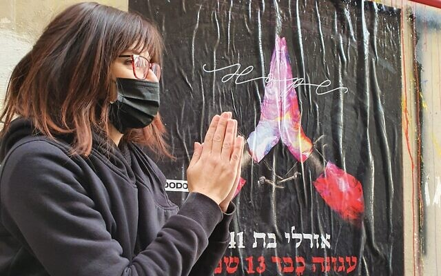 Orly, whose personal details as an aguna, a chained woman, are listed on one of the posters plastered in south Tel Aviv as part of Yom HaAguna, February 24, 2021 (Courtesy DODO)