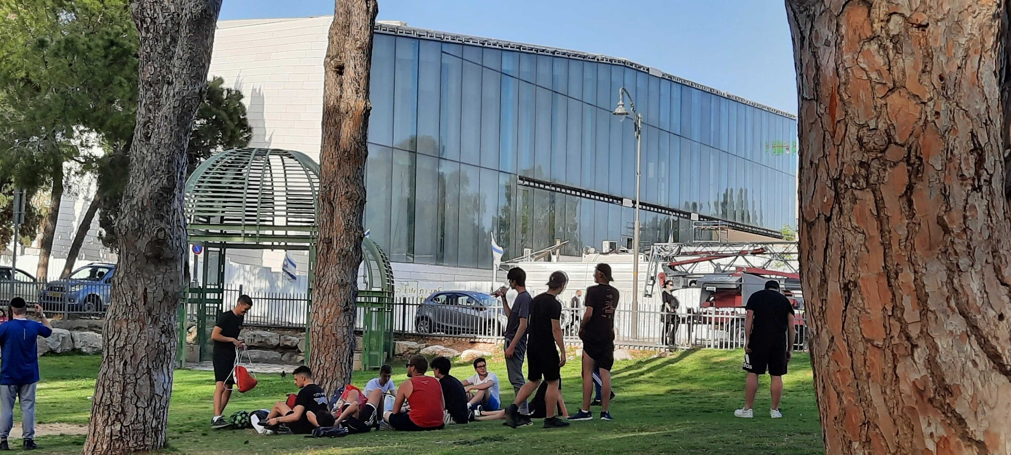 Students at a park next to the under-construction Museum of Tolerance Jerusalem on April 5, 2021. (Joshua Davidovich/Times of Israel)