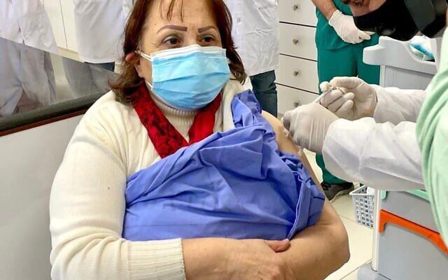 Palestinian Authority Health Minister Mai Al-Kaila receives a shot of the Moderna coronavirus vaccine on Wednesday, February 3, 2021 (WAFA)