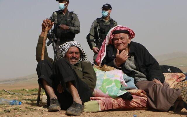 Palestinians and Israeli soldiers in Humsa al-Fouqa on Thursday, February 4, 2021 (Credit: WAFA/Suleiman Abu Srur)