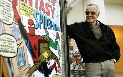 In this March 21, 2006 file photo, comic book creator Stan Lee stands beside some of his drawings in the Marvel Super Heroes Science Exhibition at the California Science Center in Los Angeles. (AP Photo/Damian Dovarganes, File)